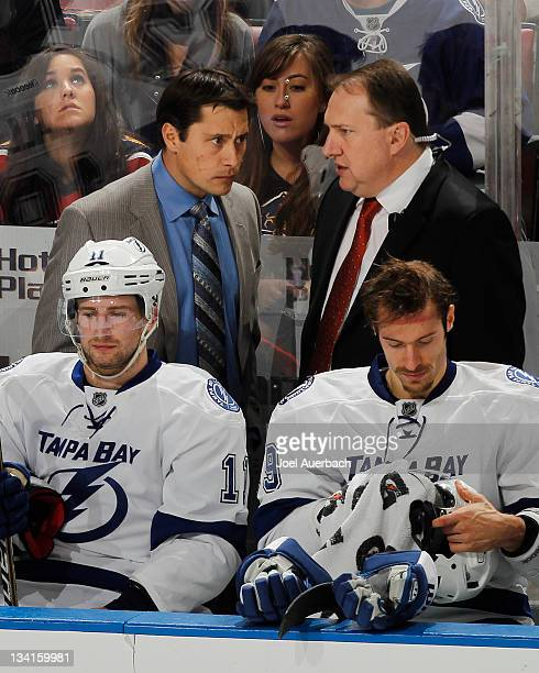Head coach Guy Boucher talks to assistant coach Martin Raymond during a time out against the Florida Panthers xx of the Tampa Bay Lightning on...