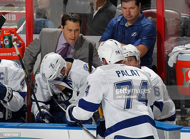 Head coach Guy Boucher talks to Ondrej Palat of the Tampa Bay Lightning during a time out against the Florida Panthers at the BBT Center on March 12...