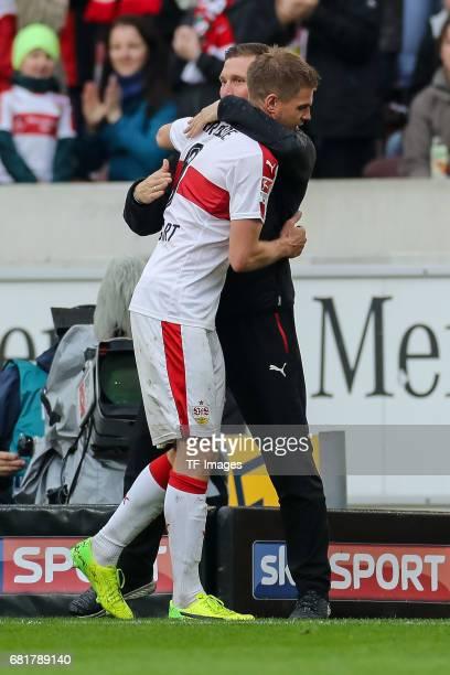 Head coach Hannes Wolf of Stuttgart shakes hands with Simon Terodde of Stuttgart during the Second Bundesliga match between VfB Stuttgart and FC...