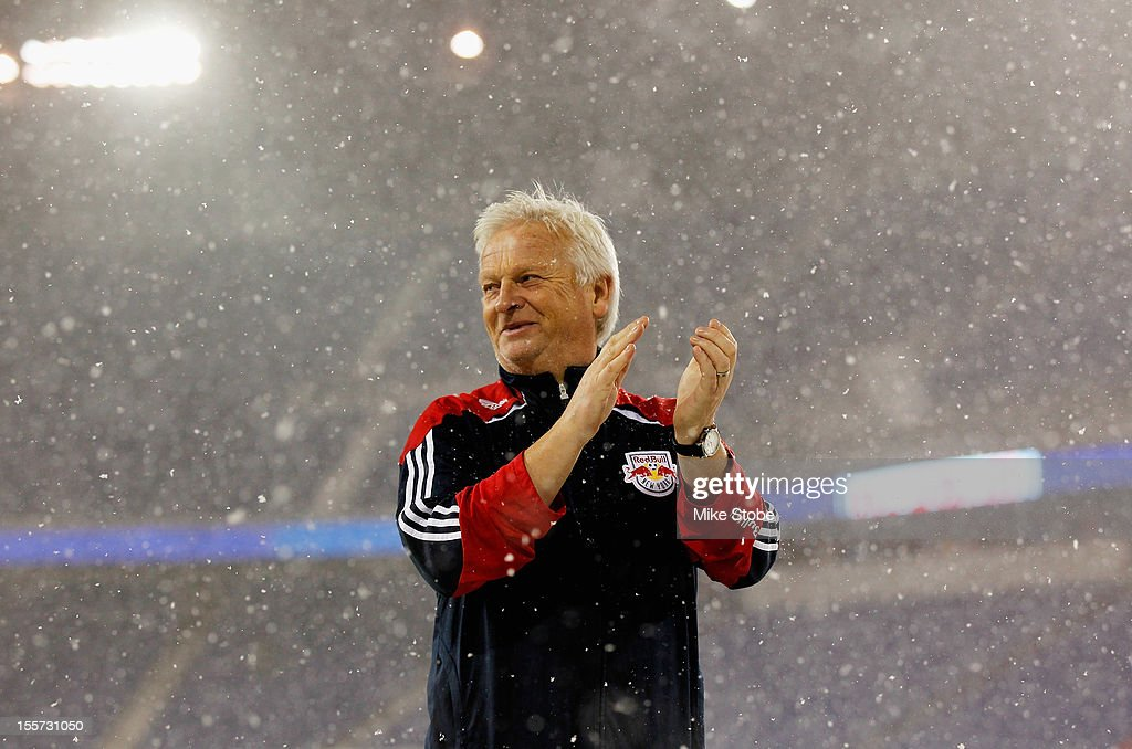Head Coach Hans Backe of the New York Red Bulls salutes the crowd after the match was called due to unfavorable weather conditions at Red Bull Arena on November 7, 2012 in Harrison, New Jersey.