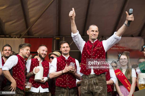 Head coach Heiko Herrlich of Jahn Regensburg is celebrating with his team and supporters the promotion to 2 Bundesliga on the Haidplatz on May 31...