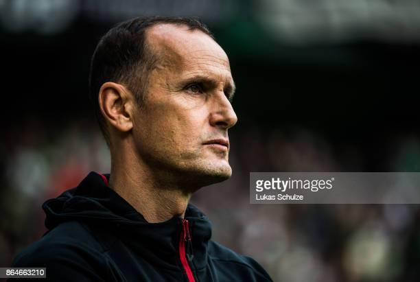 Head Coach Heiko Herrlich of Leverkusen looks up prior to the Bundesliga match between Borussia Moenchengladbach and Bayer 04 Leverkusen at...