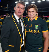 Head Coach Heyneke Meyer of South Africa and player Pat Lambie of South Africa celebrate their victory after the QBE International match between...