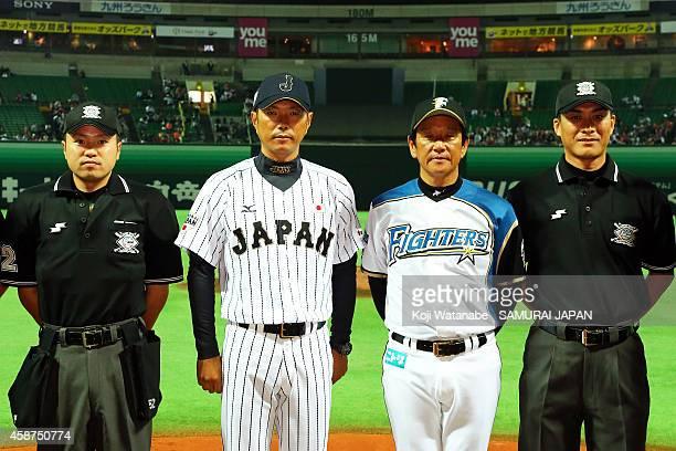 Head Coach Hiroki Kokubo of Samurai Japan and Head Coach Hideki Kuriyama of Hokkaido NipponHam Fighters poses during the friendly match between...