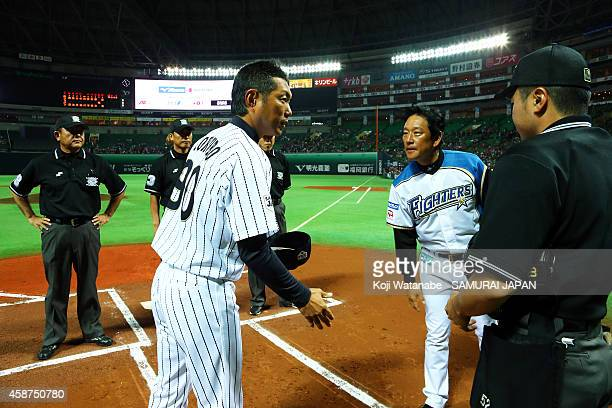 Head Coach Hiroki Kokubo of Samurai Japan and Head Coach Hideki Kuriyama of Hokkaido NipponHam Fighters in action during the friendly match between...