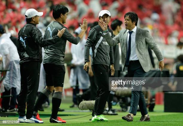Head coach Hiroshi Nanami of Jubilo Iwata high fives with his team staffs after their 42 victory in the JLeague J1 match between Urawa Red Diamonds...