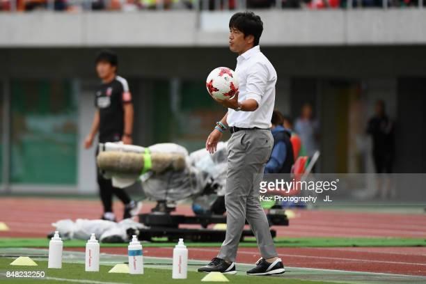 Head coach Hiroshi Nanami of Jubilo Iwata picks up the ball during the JLeague J1 match between Jubilo Iwata and Urawa Red Diamonds at Shizuoka...