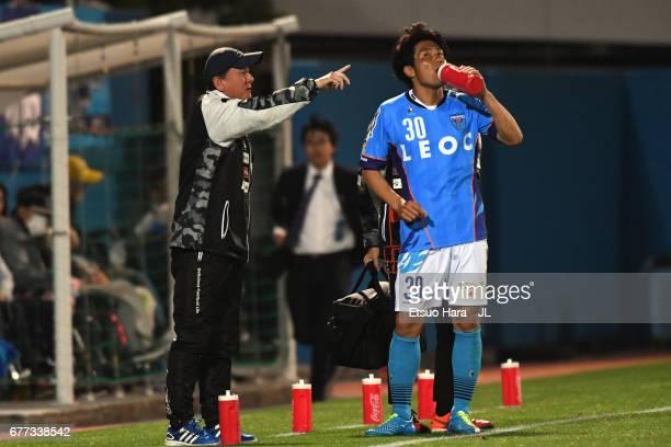 Head coach Hitoshi Nakata of Yokohama FC gives instruction to Takanobu Komiyama during the JLeague J2 match between Yokohama FC and Ehime FC at...