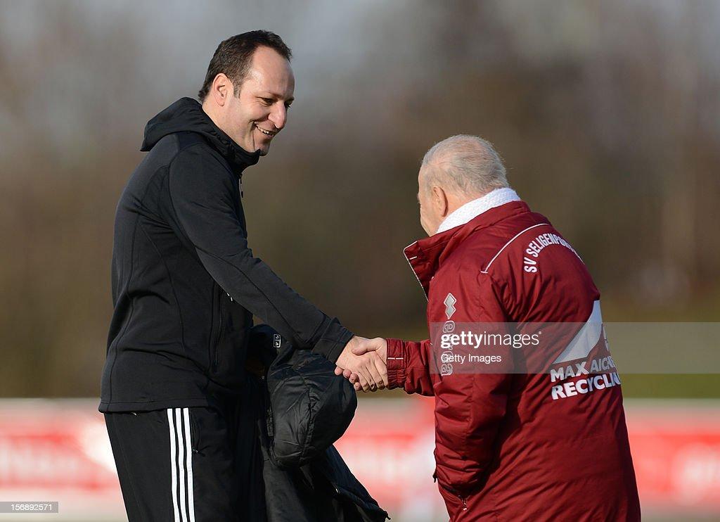 Head coach Holger Bachthaler of Illertissen (L) and head coach Karsten Wettberg of Seligenporten shake hands during the Regionalliga Bayern match between FV Illertissen and SV Seligenporten at Voehlin-Stadion on November 24, 2012 in Illertissen, Germany.