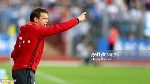 Head coach Holger Seitz of Bayern reacts during the U19 German Championship Semi Final second leg match between FC Schalke and FC Bayern at Lohrheide...