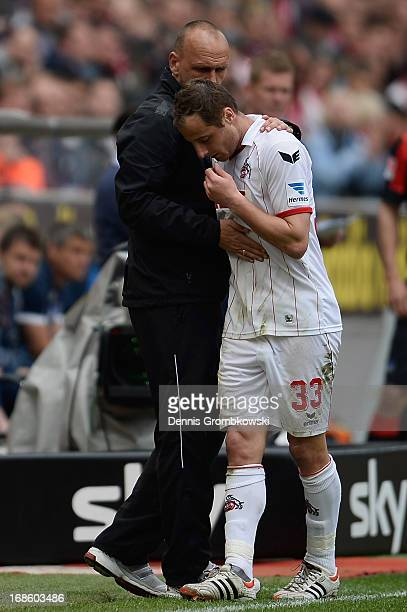 Head coach Holger Stanislawski of 1 FC Koeln hugs Matthias Lehmann during the Second Bundesliga match between 1 FC Koeln and Hertha BSC Berlin at...