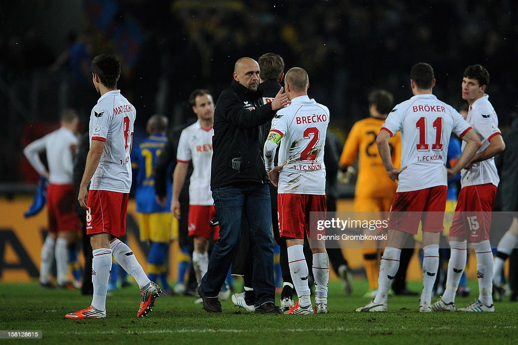 Head coach Holger Stanislawski of Cologne shakes hands with Miso Brecko after the Bundesliga match between 1. FC Koeln and Eintracht Braunschweig at RheinEnergieStadion on December 10, 2012 in Cologne, Germany.