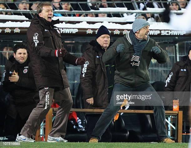 Head coach Holger Stanislawski of Hamburg celebrates after the Bundesliga match between FC St Pauli and 1 FC Kaiserslautern at Millerntor Stadium on...