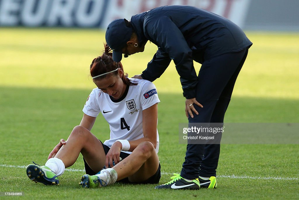 Head coach <a gi-track='captionPersonalityLinkClicked' href=/galleries/search?phrase=Hope+Powell&family=editorial&specificpeople=228832 ng-click='$event.stopPropagation()'>Hope Powell</a> of England (R) comforts Jill Scott of England after the UEFA Women's EURO 2013 Group C match between England and Russia at Linkoping Arena on July 15, 2013 in Linkoping, Sweden. The match between England and Russia ended 1-1.