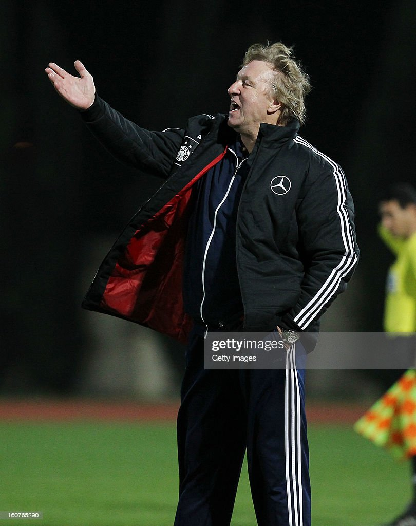 Head coach <a gi-track='captionPersonalityLinkClicked' href=/galleries/search?phrase=Horst+Hrubesch&family=editorial&specificpeople=613059 ng-click='$event.stopPropagation()'>Horst Hrubesch</a> of Germany gestures during the international friendly match between U18 Cyprus and U18 Germany at Stadio Tasos Markou on February 5, 2013 in Paralimni, Cyprus.