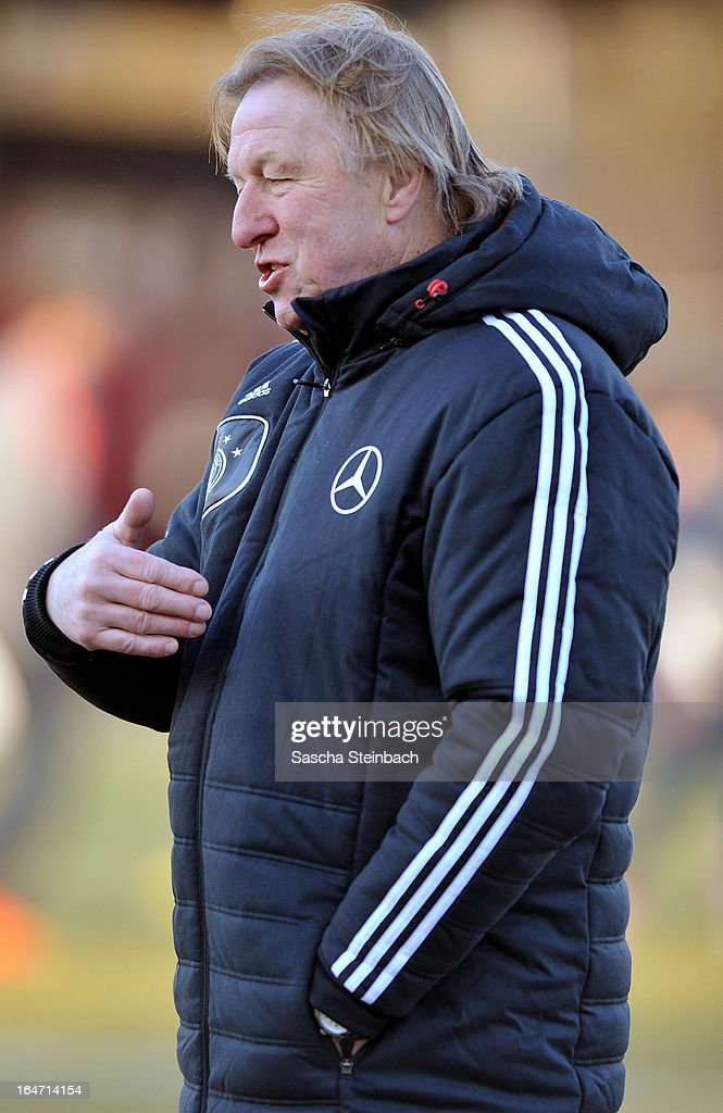 Head coach <a gi-track='captionPersonalityLinkClicked' href=/galleries/search?phrase=Horst+Hrubesch&family=editorial&specificpeople=613059 ng-click='$event.stopPropagation()'>Horst Hrubesch</a> of Germany gestures prior to the U18 International Friendly match between The Netherlands and Germany on March 26, 2013 in Vriezenveen, Netherlands.
