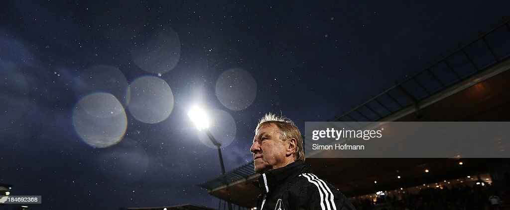 Head coach <a gi-track='captionPersonalityLinkClicked' href=/galleries/search?phrase=Horst+Hrubesch&family=editorial&specificpeople=613059 ng-click='$event.stopPropagation()'>Horst Hrubesch</a> of Germany looks on prior to the 2015 UEFA European U21 Championships Qualifying Group Six match between Germany U21 and Faroe Islands U21 at Auestadion on October 15, 2013 in Kassel, Germany.