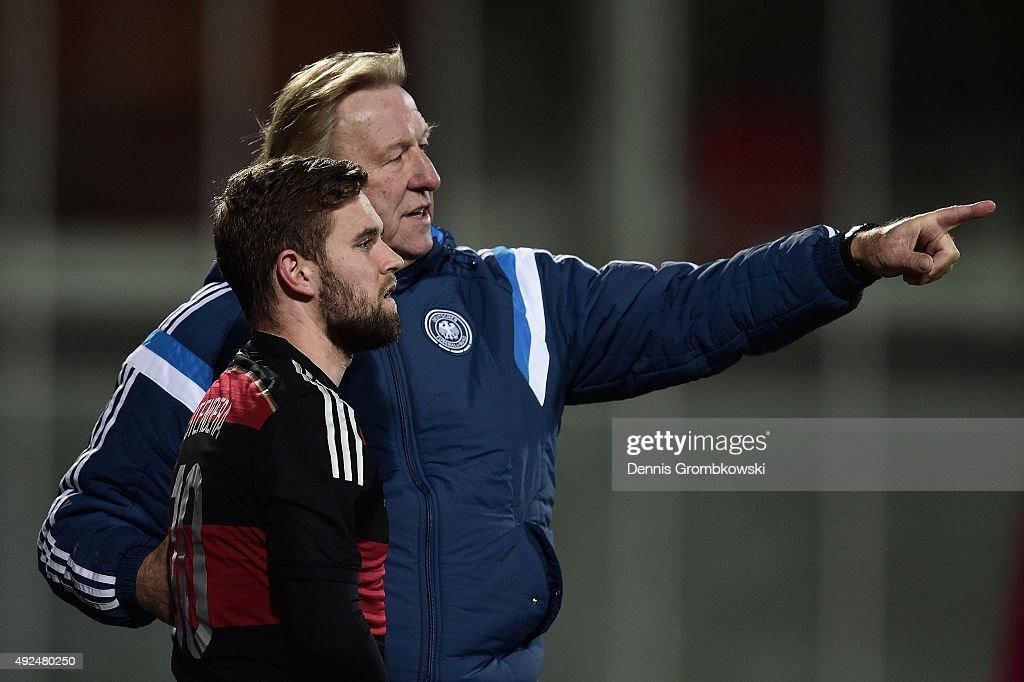 Head coach Horst Hruebesch of Germany instructs Marc Stendera during the 2017 UEFA European U21 Championships Qualifier between U21 Faroe Islands and...