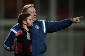Head coach Horst Hruebesch of Germany instructs Marc Stendera during the 2017 UEFA European U21 Championships Qualifier between U21 Faroe Islands and...