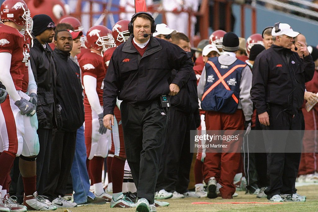 Head coach Houston Nutt of the Arkansas Razorbacks walks on the sideline during the Cotton Bowl against the Oklahoma Sooners on January 1 2002 in...