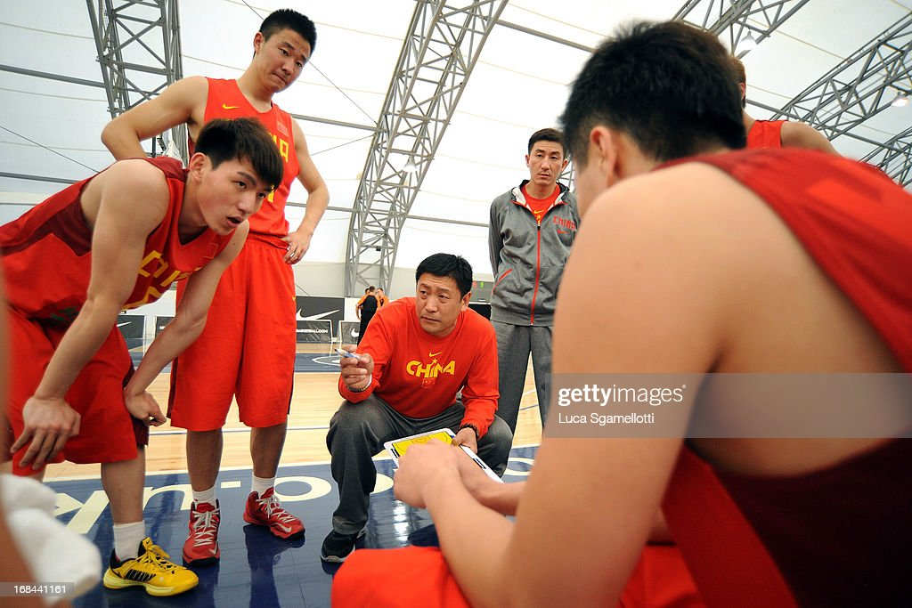 Head coach Huaiyu Wang of Team China directs his team during the Nike International Junior Tournament game between Team China Vs Crvena Zvezda Telekom Belgrade at Soccerdome on May 9, 2013 in London, United Kingdom.
