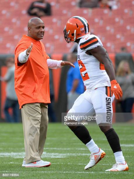 Head coach Hue Jackson of the Cleveland Browns high fives safety Jabrill Peppers prior to a preseason game on August 10 2017 against the New Orleans...