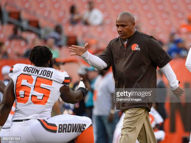 Head coach Hue Jackson of the Cleveland Browns shakes hands with defensive lineman Larry Ogunjobi prior to a preseason game on April 27 2017 against...