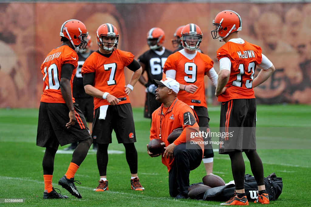 Head coach <a gi-track='captionPersonalityLinkClicked' href=/galleries/search?phrase=Hue+Jackson&family=editorial&specificpeople=2287912 ng-click='$event.stopPropagation()'>Hue Jackson</a> of the Cleveland Browns talks with quarterbacks <a gi-track='captionPersonalityLinkClicked' href=/galleries/search?phrase=Robert+Griffin&family=editorial&specificpeople=2495030 ng-click='$event.stopPropagation()'>Robert Griffin</a> III #10, <a gi-track='captionPersonalityLinkClicked' href=/galleries/search?phrase=Josh+McCown&family=editorial&specificpeople=182518 ng-click='$event.stopPropagation()'>Josh McCown</a> #13, <a gi-track='captionPersonalityLinkClicked' href=/galleries/search?phrase=Austin+Davis&family=editorial&specificpeople=1058943 ng-click='$event.stopPropagation()'>Austin Davis</a> #7, and <a gi-track='captionPersonalityLinkClicked' href=/galleries/search?phrase=Connor+Shaw+-+American+Football+Player&family=editorial&specificpeople=9849665 ng-click='$event.stopPropagation()'>Connor Shaw</a> #9 during a voluntary mini camp on April 21, 2016 at the Cleveland Browns training facility in Berea, Ohio.