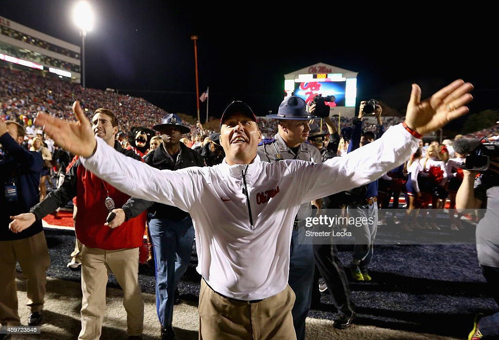 Head coach <a gi-track='captionPersonalityLinkClicked' href=/galleries/search?phrase=Hugh+Freeze&family=editorial&specificpeople=9725187 ng-click='$event.stopPropagation()'>Hugh Freeze</a> of the Mississippi Rebels celebrates after defeating the Mississippi State Bulldogs 31-17 at Vaught-Hemingway Stadium on November 29, 2014 in Oxford, Mississippi.