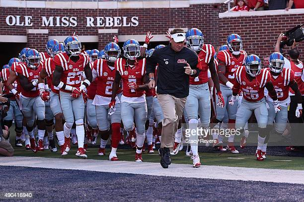 Head coach Hugh Freeze of the Mississippi Rebels leads his team onto the field prior to a game against the Vanderbilt Commodores at VaughtHemingway...