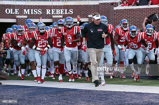 Head coach Hugh Freeze of the Mississippi Rebels takes the field with his team prior to a game against the Vanderbilt Commodores at VaughtHemingway...