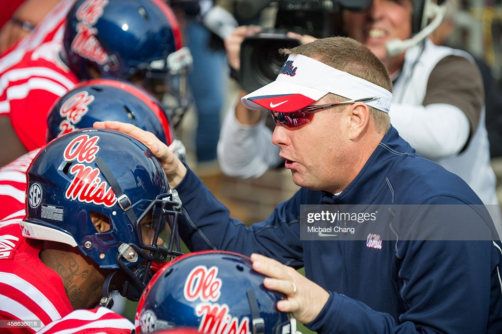 Head coach <a gi-track='captionPersonalityLinkClicked' href=/galleries/search?phrase=Hugh+Freeze&family=editorial&specificpeople=9725187 ng-click='$event.stopPropagation()'>Hugh Freeze</a> of the Mississippi Rebels talks to his players prior to their game against the Presbyterian Blue Hose on November 8, 2014 at Vaught-Hemingway Stadium in Oxford, Mississippi. The Mississippi Rebels defeated the Presbyterian Blue Hose 48-0.