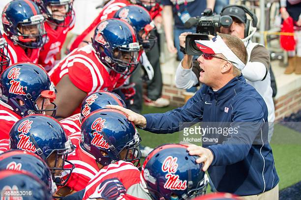 Head coach Hugh Freeze of the Mississippi Rebels talks to his players prior to their game against the Presbyterian Blue Hose on November 8 2014 at...