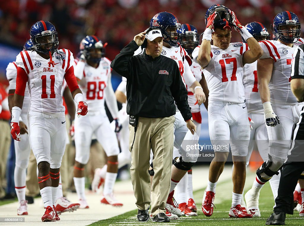 Head coach <a gi-track='captionPersonalityLinkClicked' href=/galleries/search?phrase=Hugh+Freeze&family=editorial&specificpeople=9725187 ng-click='$event.stopPropagation()'>Hugh Freeze</a> of the Ole Miss Rebels looks on in the third quarter against the TCU Horned Frogs during the Chik-fil-A Peach Bowl at Georgia Dome on December 31, 2014 in Atlanta, Georgia.