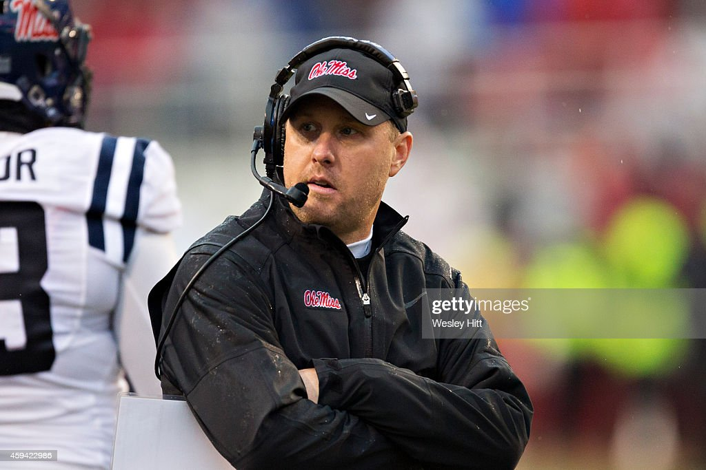 Head Coach <a gi-track='captionPersonalityLinkClicked' href=/galleries/search?phrase=Hugh+Freeze&family=editorial&specificpeople=9725187 ng-click='$event.stopPropagation()'>Hugh Freeze</a> of the Ole Miss Rebels on the field during a timeout in the second quarter against the Arkansas Razorbacks in second quarter at Razorback Stadium on November 22, 2014 in Fayetteville, Arkansas.