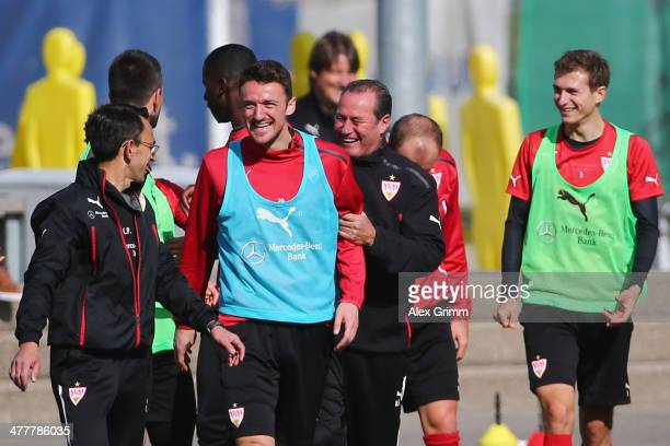 Head coach Huub Stevens laughs with Christian Gentner during a VfB Stuttgart training session at the club's training ground on March 11 2014 in...