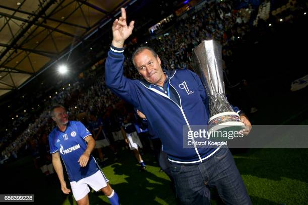 Head coach Huub Stevens of Schalke does a lap of honour with the Uefa Cup trophy after the 20 years of Eurofighter match between Eurofighter and...