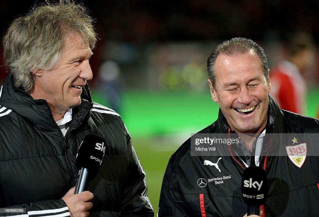 Head coach Huub Stevens of Stuttgart talks to Head coach Gertjan Verbeek of Nuernberg during a TV interview prior to the Bundesliga match between 1...