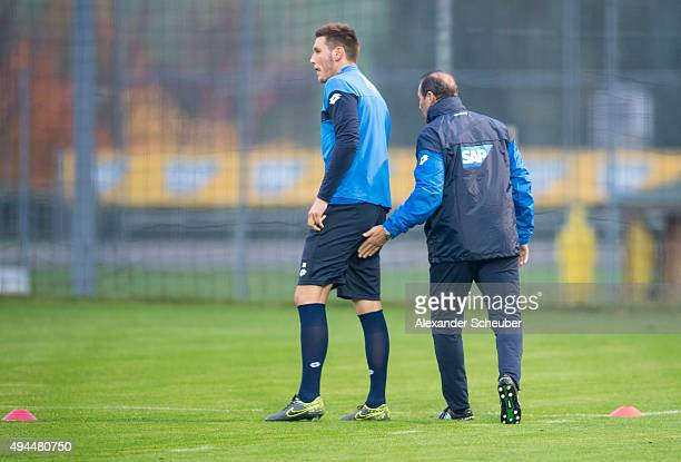 Head coach Huub Stevens of TSG 1899 Hoffenheim attends a training session with Niklas Suele of TSG 1899 Hoffenheim at the 1899 academy on October 27...