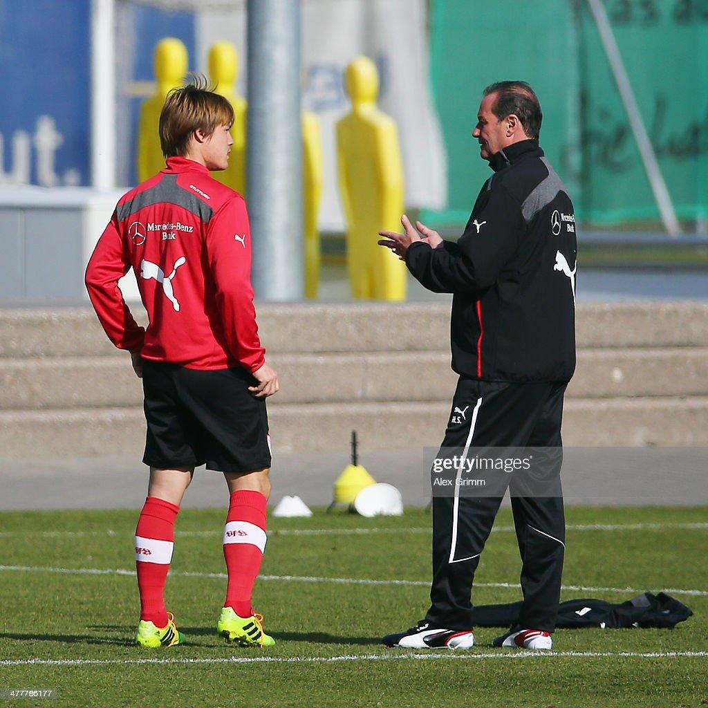 Head coach Huub Stevens talks to Gotoku Sakai during a VfB Stuttgart training session at the club's training ground on March 11, 2014 in Stuttgart, Germany.