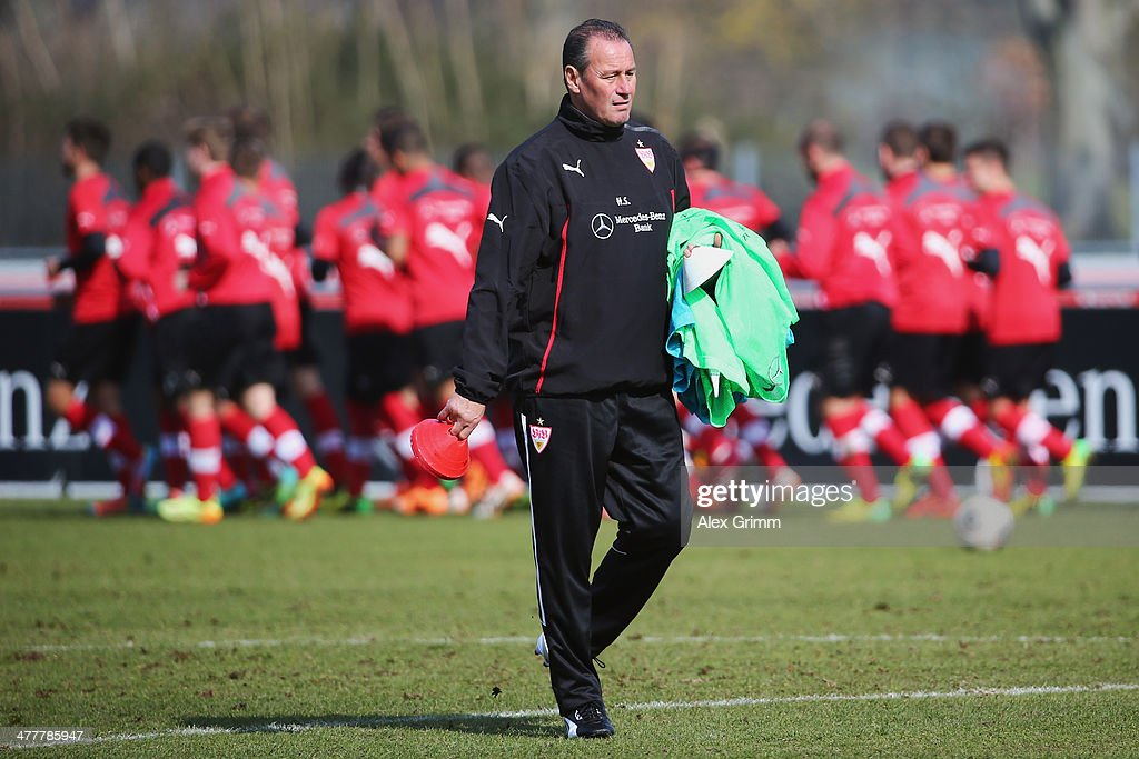 Head coach Huub Stevens walks on the pitch during a VfB Stuttgart training session at the club's training ground on March 11, 2014 in Stuttgart, Germany.