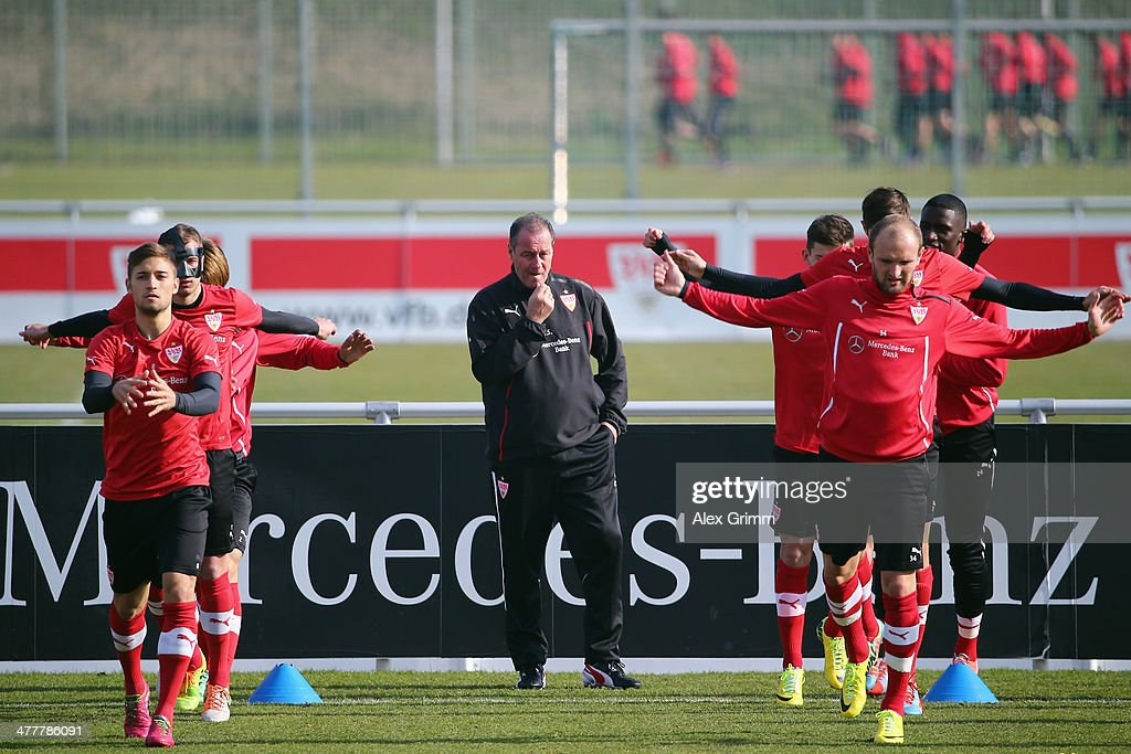 Head coach Huub Stevens watches his players exercise during a VfB Stuttgart training session at the club's training ground on March 11, 2014 in Stuttgart, Germany.