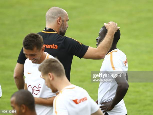 Head coach Igor Tudar speaks with Badou Ndiaye of Galatasaray during a training session in Bad Waltersdor town of Graz Austria on August 04 2017