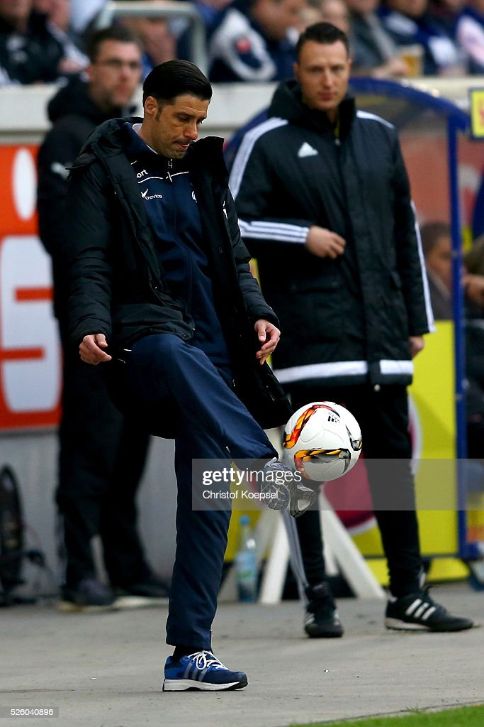 Head coach Ilia Gruev of Duisburg kicks the ball during the 2. Bundesliga match between MSV Duisburg and Fortuna Duesseldorf at Schauinsland-Reisen-Arena on April 29, 2016 in Duisburg, Germany.