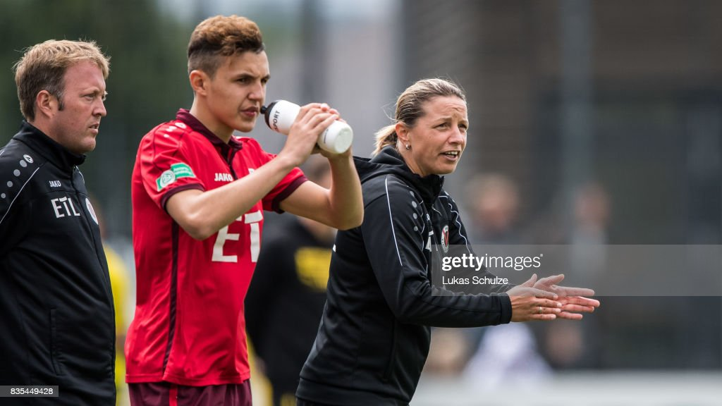 Head Coach Inka Grings (R) gestures during the B Juniors Bundesliga match between Borussia Dortmund and FC Viktoria Koeln on August 19, 2017 in Dortmund, Germany.