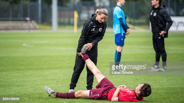 Head Coach Inka Grings helps Can Karaguemrueklue of Koeln during the B Juniors Bundesliga match between Borussia Dortmund and FC Viktoria Koeln on...
