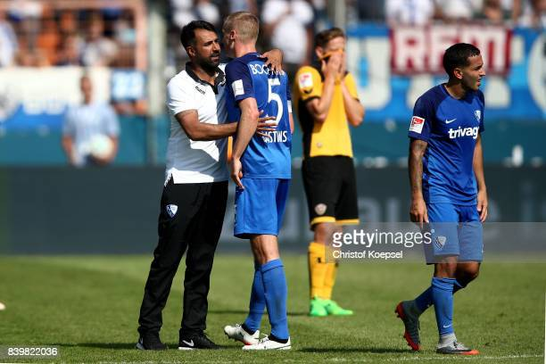 Head coach Ismail Atalan of Bochum embraces Felix Bastians after winning 32 the Second Bundesliga match between VfL Bochum 1848 and SG Dynamo Dresden...
