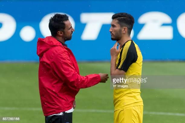 Head coach Ismail Atalan of Bochum speak with Nuri Sahin of Dortmund during the preseason friendly match between VfL Bochum and Borussia Dortmund at...
