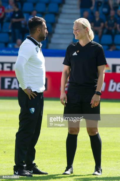Head coach Ismail Atalan of Bochum speak with Referee Bibiana Steinhaus during the Second Bundesliga match between VfL Bochum 1848 and SG Dynamo...