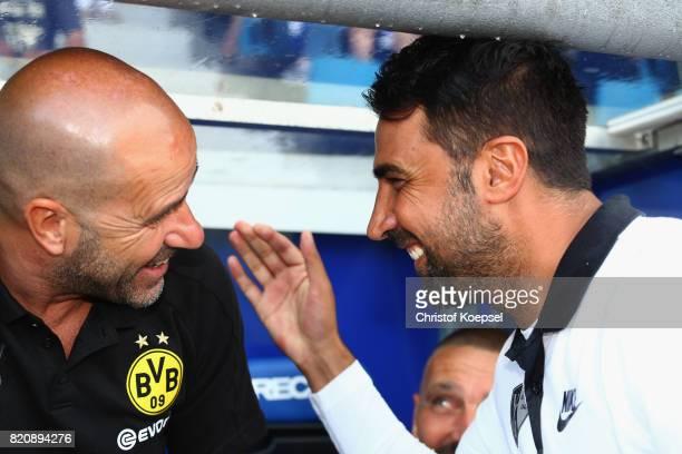 Head coach Ismail Atalan of Bochum welcomes head coach Peter Bosz of Dortmund during the preseason friendly match between VfL Bochum and Borussia...